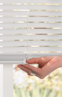 cordless blinds image showing a hand easily lifting/tilting a white cordless vinyl mini SUYMURW