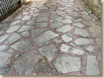 crazy paving poorly laid concrete flagstones. wide joints reveal too much mortar PKDRPOQ