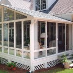 enclosed patio white aluminum frame sunroom with gable