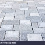 gray interlocking paving stone driveway from above -