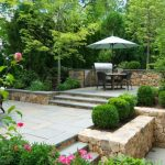 wellesley, ma - tiered stone patio with grill