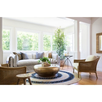 Using the round jute rug for   better looking living rooms