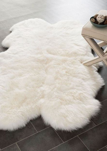 Obsessing over this white faux sheepskin rug that goes perfect in a