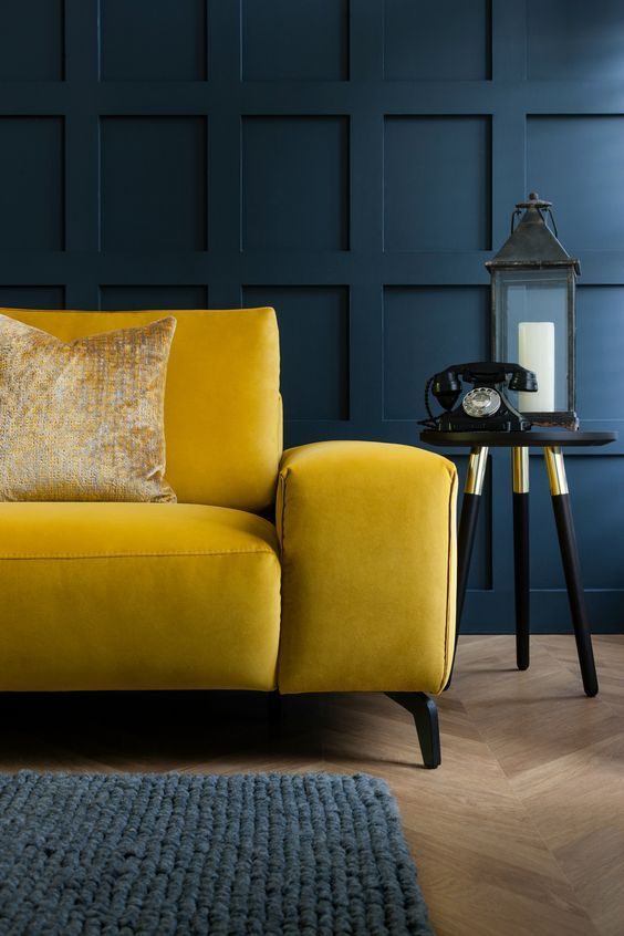 Luxury mustard yellow sofa perfect for dark moody living rooms
