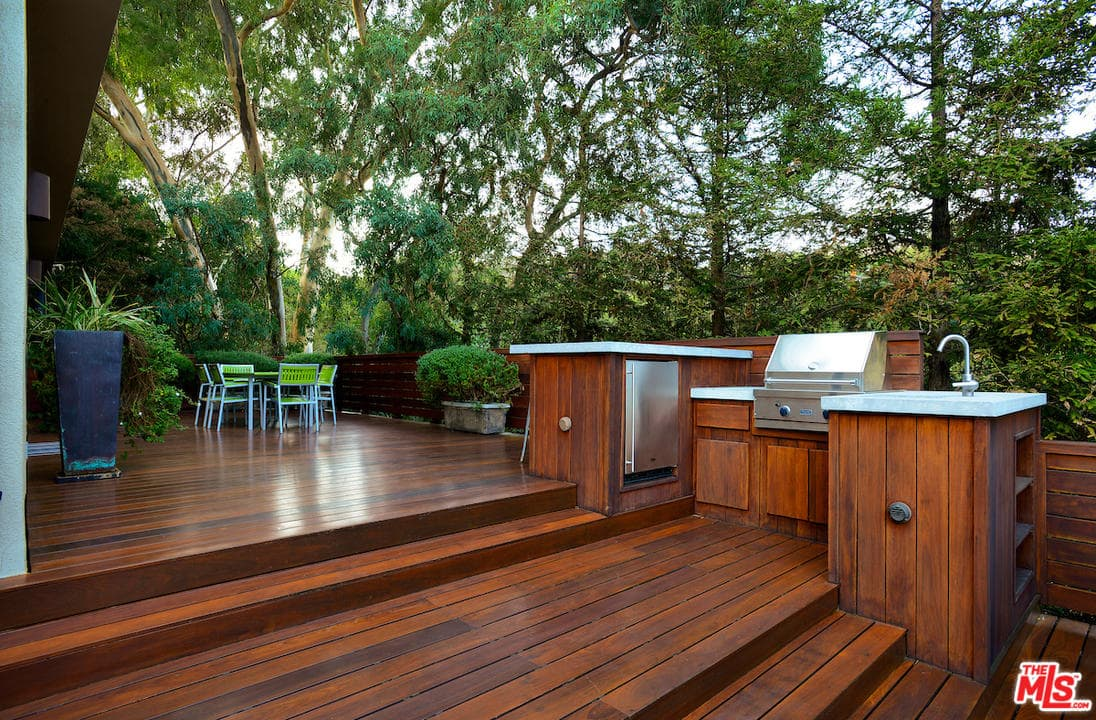 backyard decks a spacious deck features a barbecue area and a patio perfect for JSTLXGJ