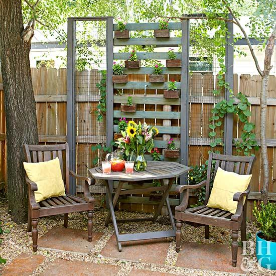 backyard ideas vertical planter with pallets and fence