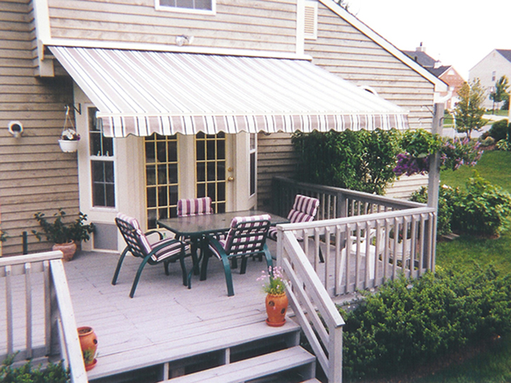 deck awnings striped awning over double doors with outdoor chairs and table on a GLIEFYJ