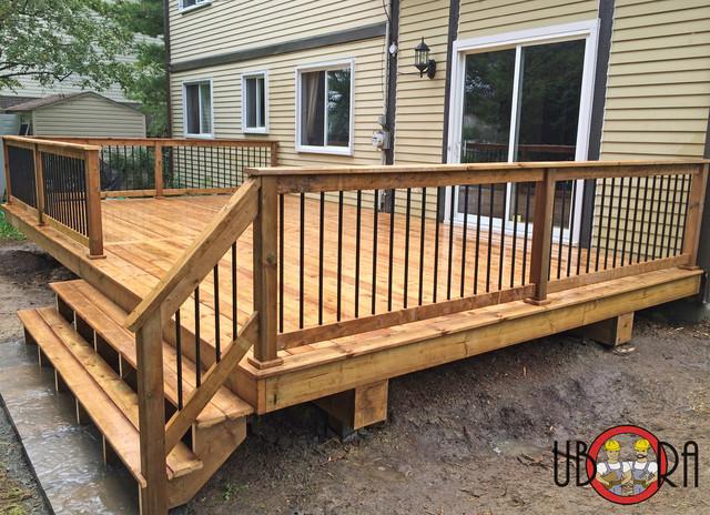 deck spindles wood deck with black metal spindle railings deck montreal metal deck OZYHWZX