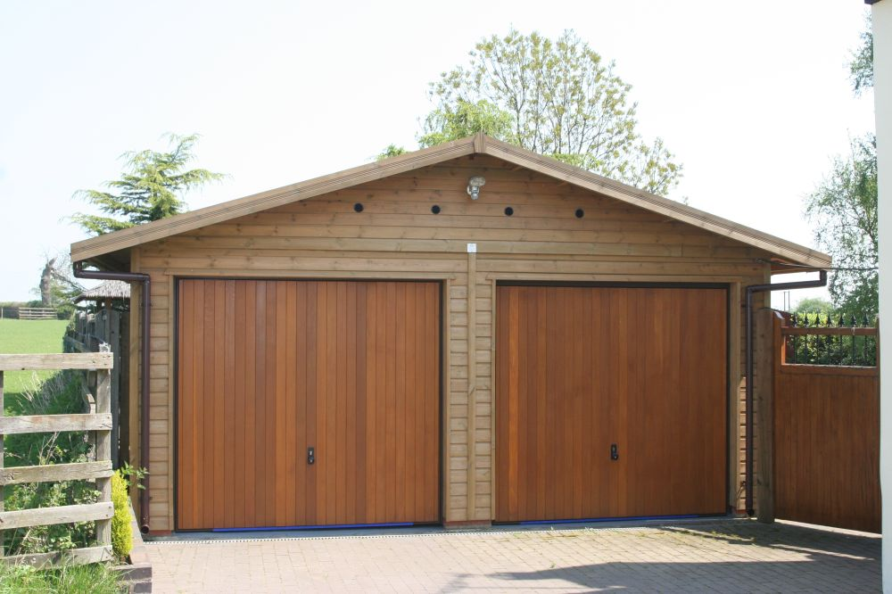 double garage with cedar up u0026 over doors in the gable end MABAXWP