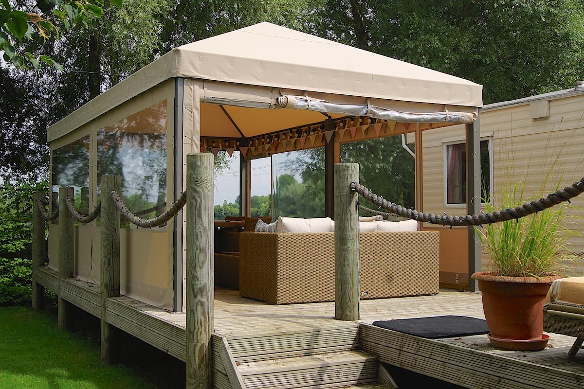 garden decking ideas a decking seating area under a gazebo CMXACXW