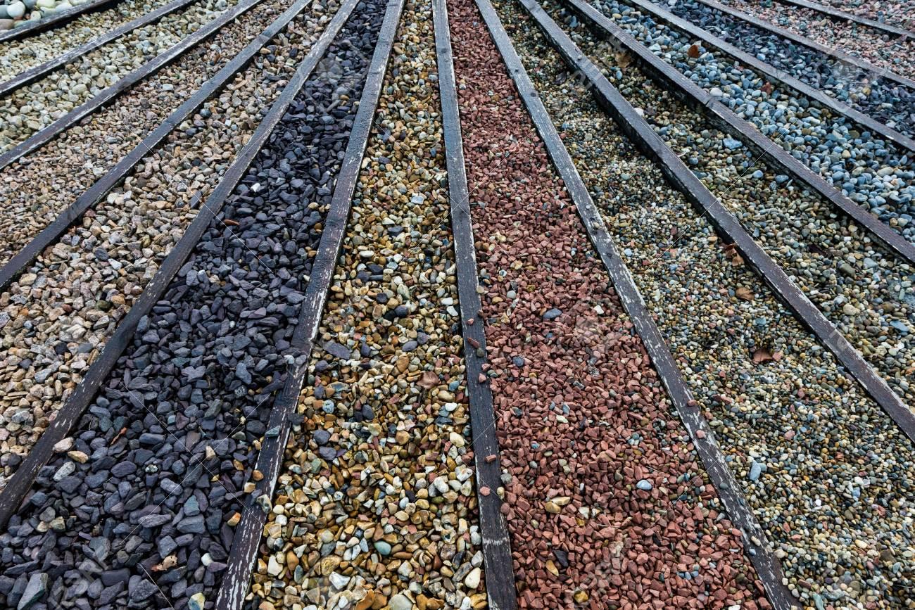 garden pebbles stock photo - various types of stone and gravel pebbles for garden DNLKLTA