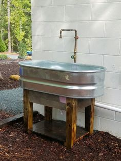 garden sink stock tank sink. pallet wood base. FMTVGRC