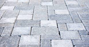 gray interlocking paving stone driveway from above - stock image ODUZJGM