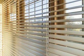 horizontal blinds gleaming horizontal wood blinds run across a bank of windows. WRFBRKE