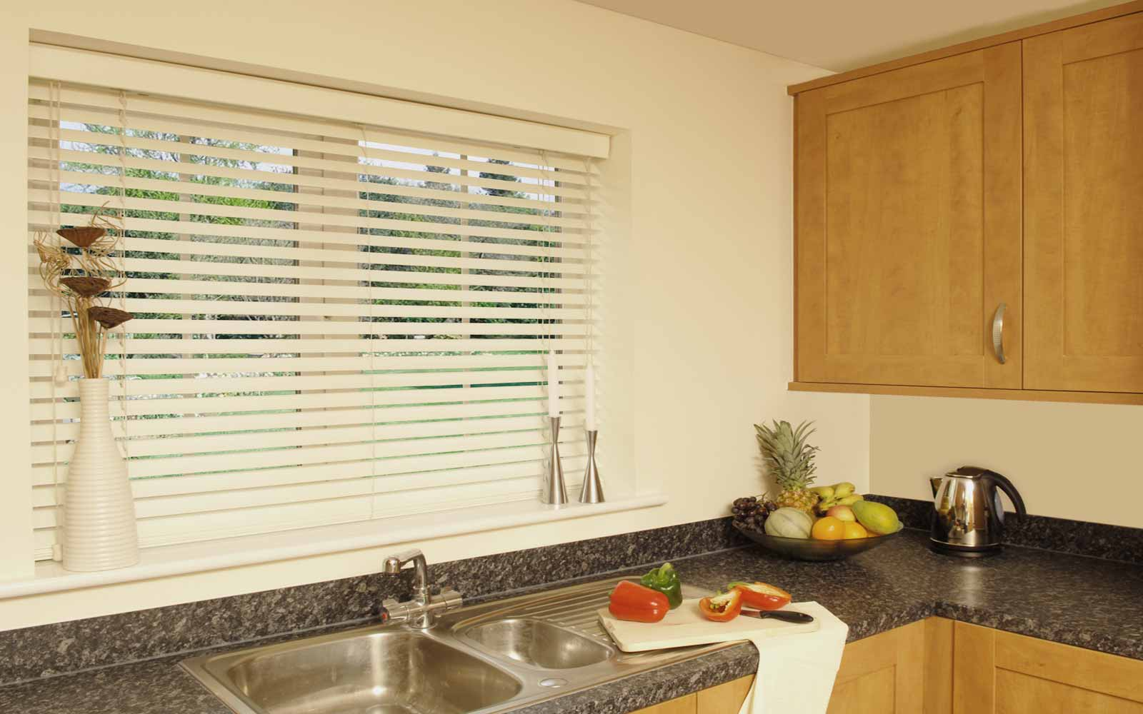 kitchen blinds faux wood venetian blinds in a kitchen KELCCXJ