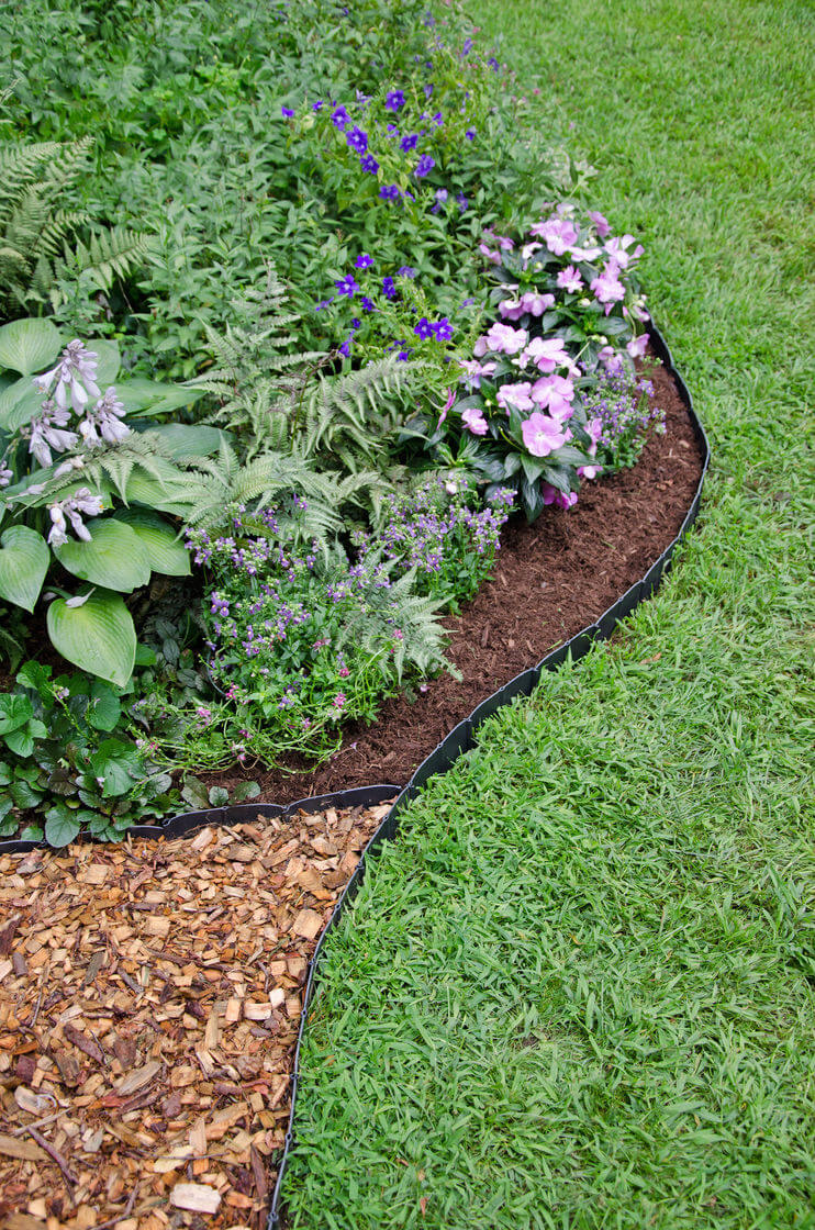 landscape edging ideas understated black plastic mulch edging