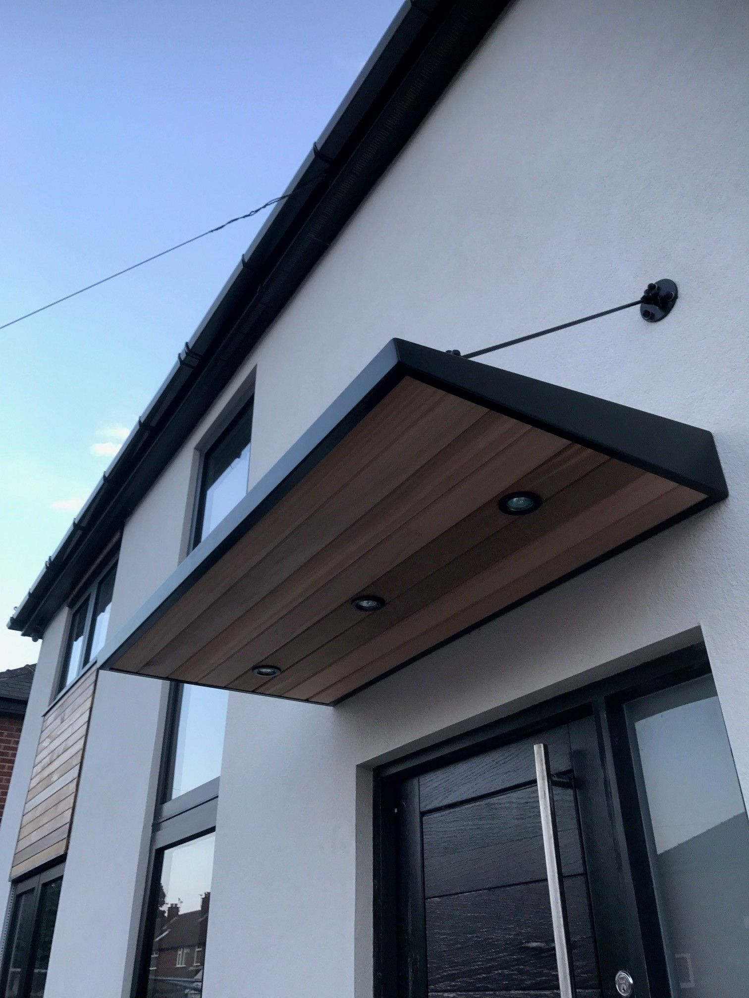 metal door canopy with cladding and entrance light