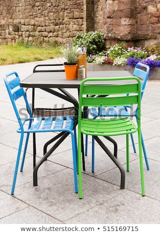 metal garden chairs metal garden furniture of table and chairs on a patio or street CHVUGEQ