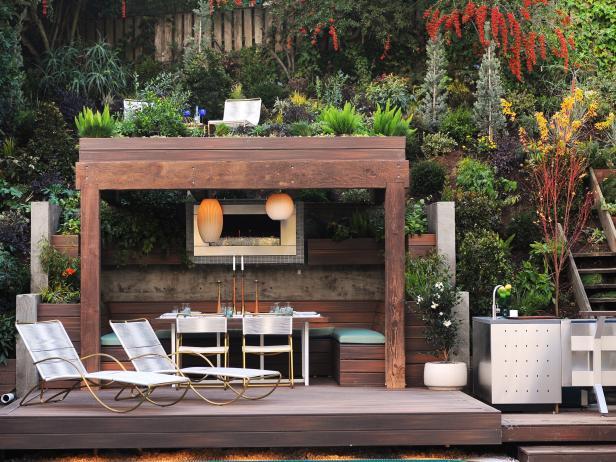 outdoor fireplace ideas small fireplace beneath pergola BYMCVTF