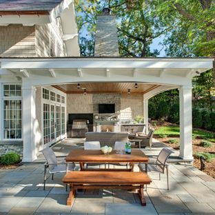 outdoor patio ideas inspiration for a timeless backyard stone patio remodel in minneapolis with PJXJWEO