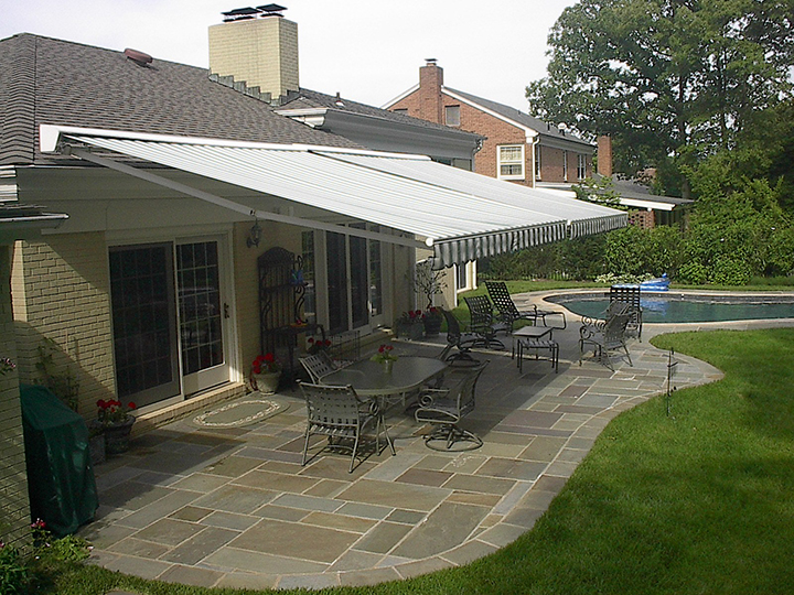 patio awnings two retractable awnings side by side over a stone patio with a IWLPQMH