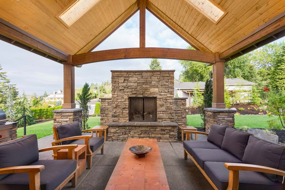 patio fireplace stone screened fireplace beneath arched wood patio XTJQNWU