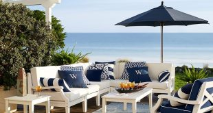 preppy navy and white patio furniture make for the perfect seaside setting. UNBYVPO