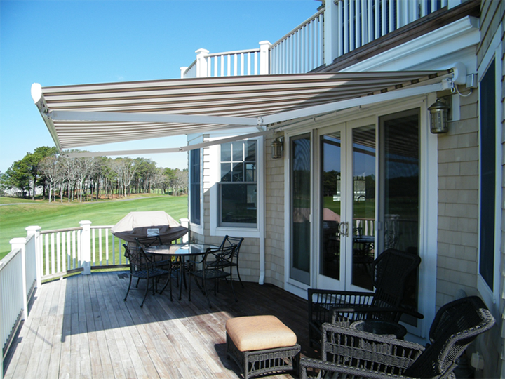 retractable canopy cream and brown striped awning extended over residential deck area IWIGYRV