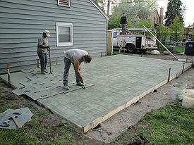 stamped concrete concrete being stamped with an ashlar slate pattern MAEZUBZ