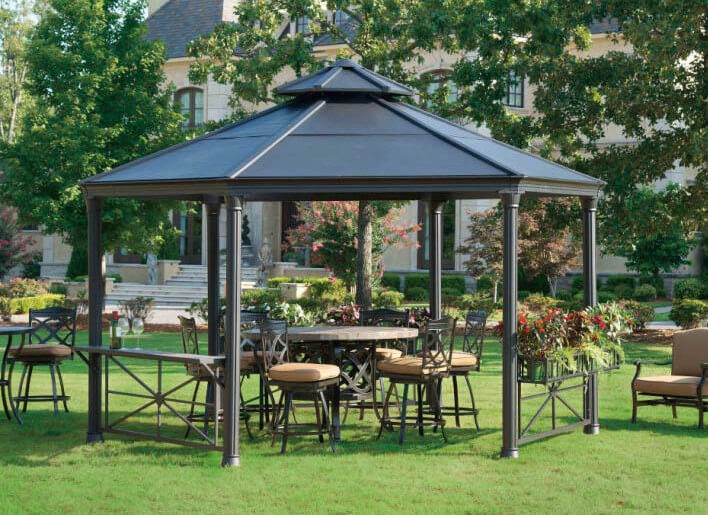 this metal gazebo houses some marvelous hard furniture