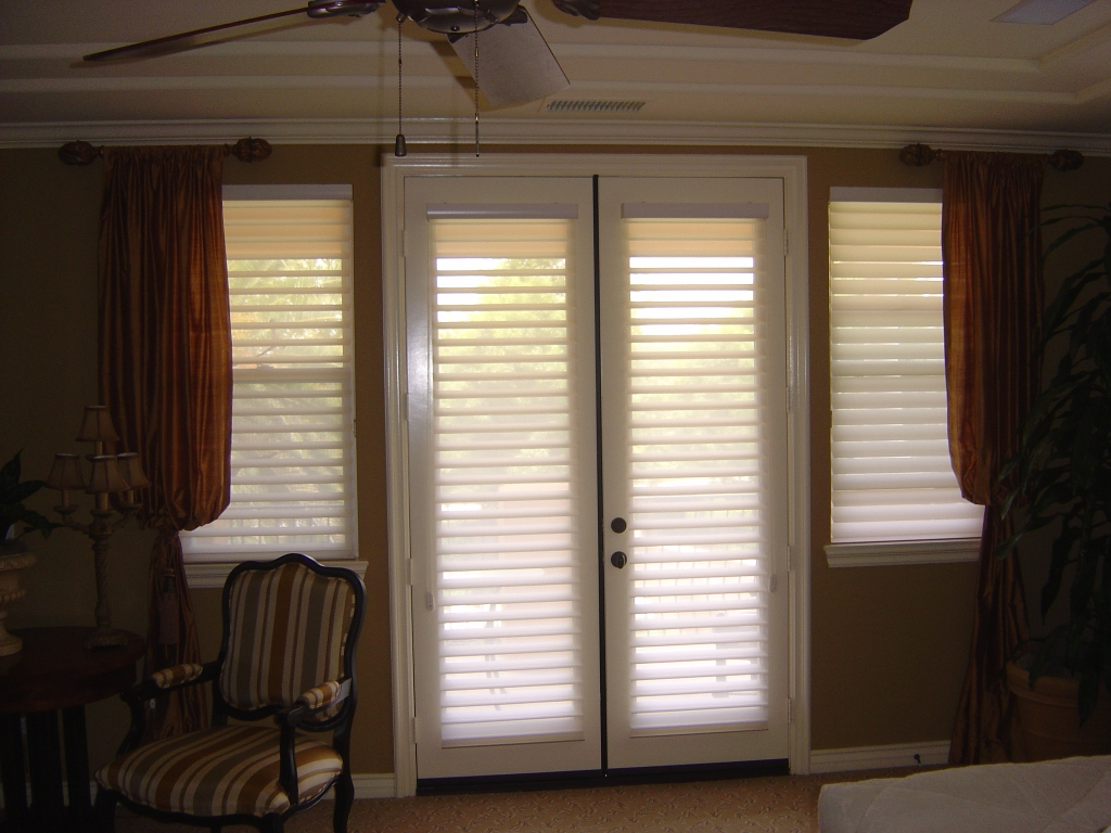window treatments for french doors hunter douglas silhouette shades on french doors combined with drapery  treatments CORKSYW