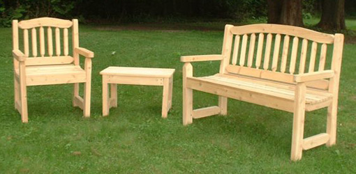 wood outdoor furniture cypress bench, chair, and table on lawn BFTHHOU