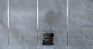 Grey marble bathroom wall panels with chrome silver strips, Cladding