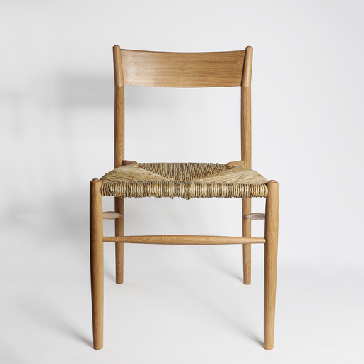 NON STANDARD OAK DINING CHAIR WITH WOVEN RUSH SEAT