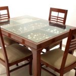 A great replacement for a traditional wooden table: glass top dining table